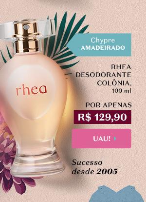 Ao lado, temos Rhea Desodorante Colônia, 100 ml, Por R$ 129,90. Temos a tag: Chypre Amadeirado + Sucesso desde 2005. Com o botão: Uau!